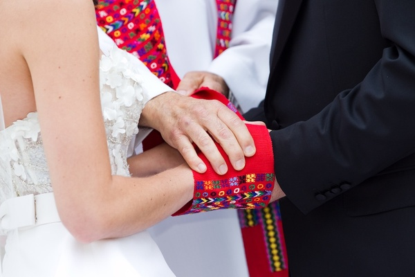Catholic wedding hand fasting ceremony for bride and groom