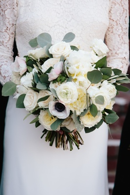 bridal bouquet with ivory roses, garden roses, anemones, and eucalyptus leaves