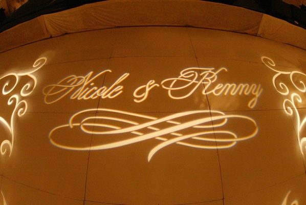 Bride and groom names illuminated on floor
