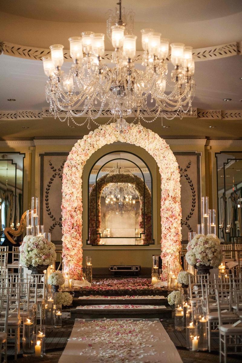 Ceremony dcor photos ballroom ceremony entrance inside weddings flower arch and petal aisle under crystal chandelier arubaitofo Choice Image