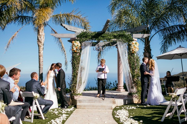 Sisters host double wedding at outdoor venue in malibu california two brides two grooms double wedding sisters at malibu wedding ceremony junglespirit Images