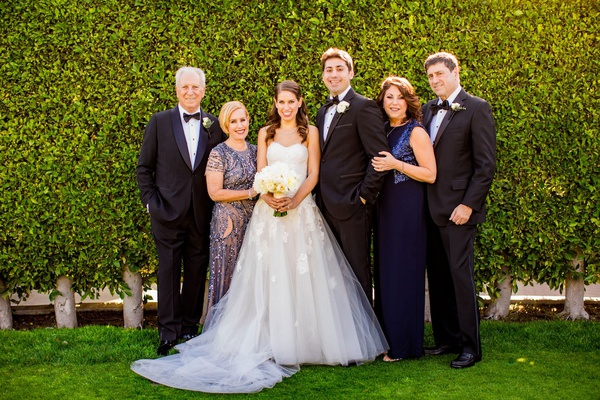 wedding portrait bride and groom with parents mothers in sequin navy blue dresses