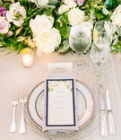 Wedding reception place setting flower and greenery runner white purple rose lavender flower motif