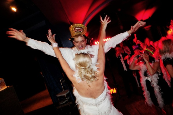 Couple wears New Year's Eve hat and feather boas