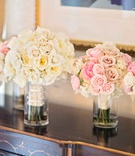 bride and bridesmaids bouquets with pink, white, and yellow roses