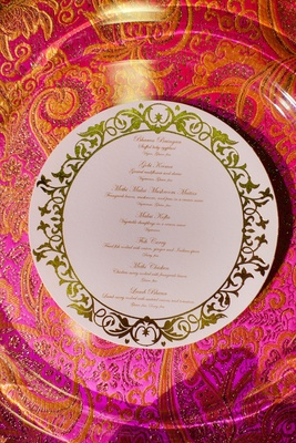 White and gold circular menu card on silk linens