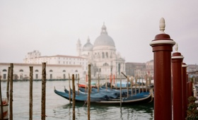 View of canal and gondola boats in Venice Italy wedding destination