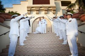 Navy men in dress whites on tile steps