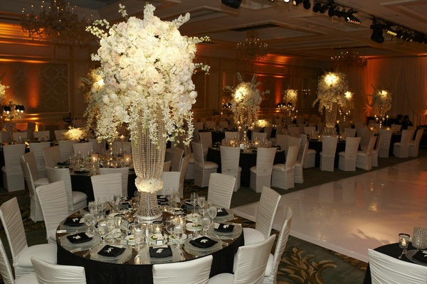 White roses and flowers on large crystal strand stand