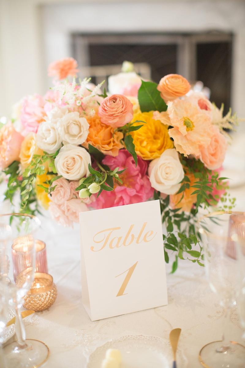wedding table number gold card pink yellow orange flowers rose peony ranunculus greenery