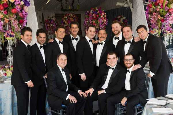 Groom And Groomsmen In Black Tuxes Bow Ties White Wedding Cake With Purple