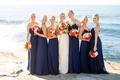 bride bridesmaids navy colorful bouquets seaside cliff side buns beachy wedding california