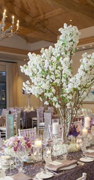 Exposed wooden beams and purple tablescapes
