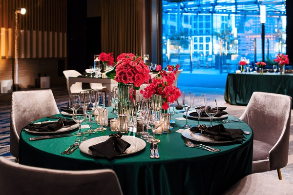wedding inspirational styled shoot, round table with forest green linens, bright pink roses