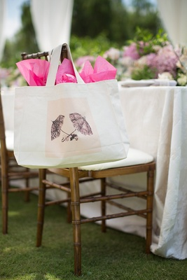 outdoor wedding shower with tote bag decorated with a vintage parasol graphic on wood chiavari chair