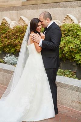 bride in strapless vera wang wedding dress long veil hair down groom in tuxedo suit washington dc