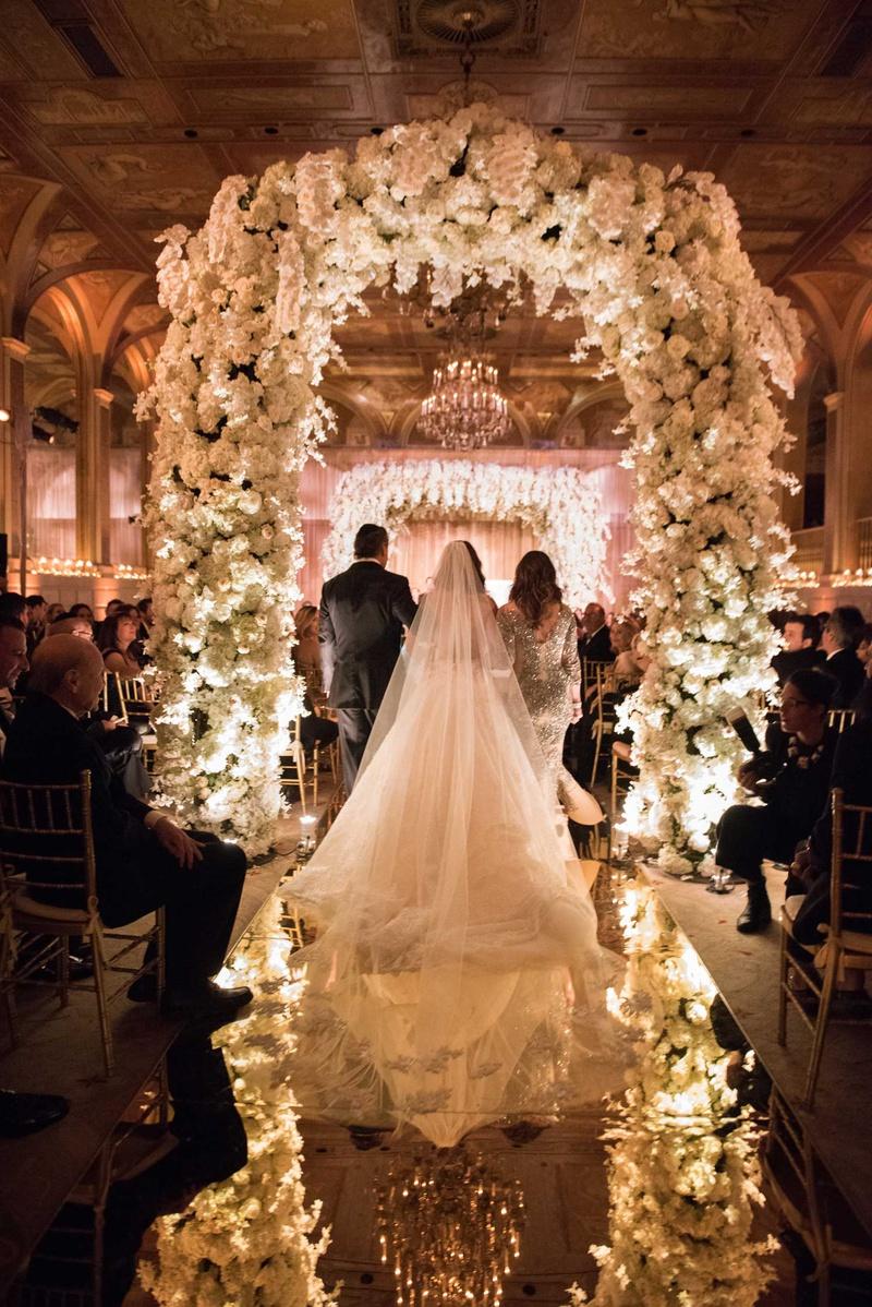 the plaza wedding ceremony flower arch mirror aisle jewish wedding ceremony
