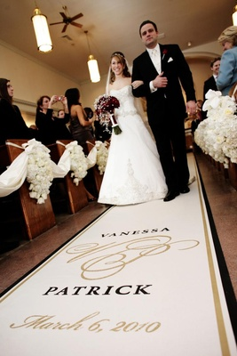 Bride in a strapless A-line gown is walked down the aisle by her father isn a black tuxedo