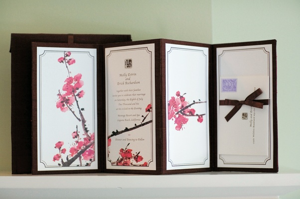 white and black invitations with pink cherry blossom pattern
