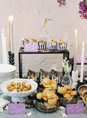 wedding event food display calzone on mini armchair, chicken sandwiches, black white stripes