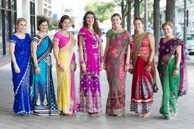 bride and bridesmaids in traditional saris