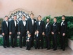 Groom with groomsmen tuxedo with pocket square bow tie and two ring bearer in matching outfits