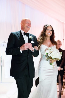 Heidi Mueller escorted to the chandelier by her father at her wedding