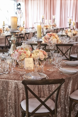 Wedding reception table with sequin linen and pink peonies