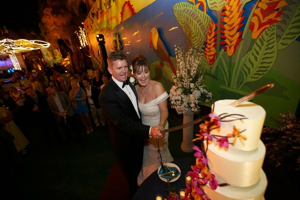 Couple cut wedding cake at San Diego Zoo