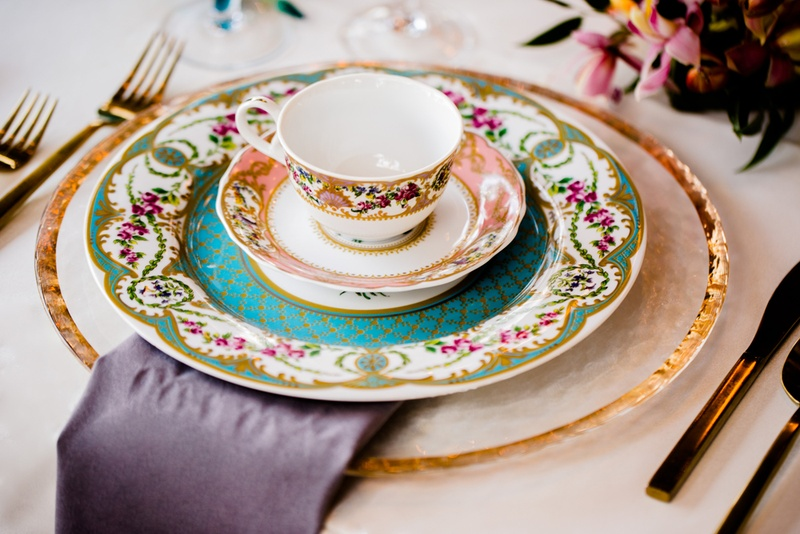 vintage patterned china as place setting for alice in wonderland inspired wedding styled shoot