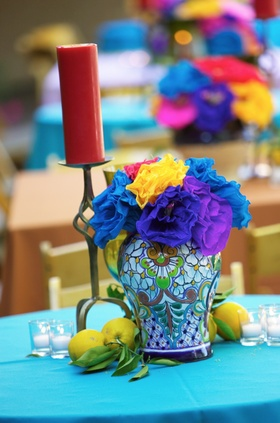 Brightly colored flower arrangement with lemons