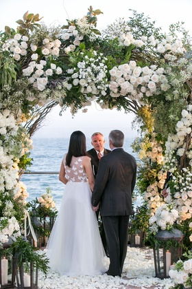 Santa Barbara vow renewal wedding green neutral color palette white flowers arch design flower petal