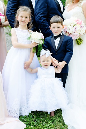 wedding party two flower girls holding hands baby toddler child little ring bearer navy blue tuxedo