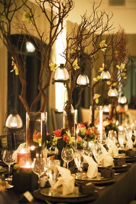 Tree branch centerpiece on long wedding table