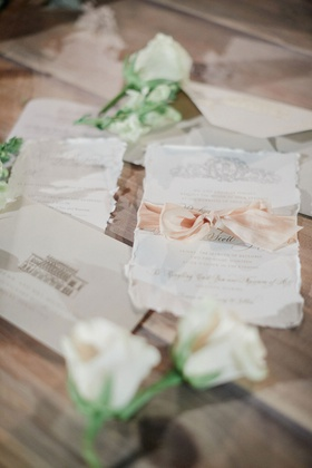 wedding invitations with deckled edges and a blush silk ribbon