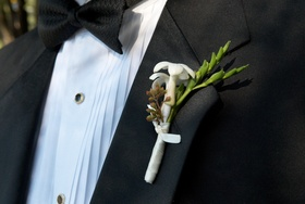 tiny white blossom and green stem boutonniere