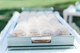 Wedding place cards for oceanfront ceremony seashell place cards in light blue tray on bar cart