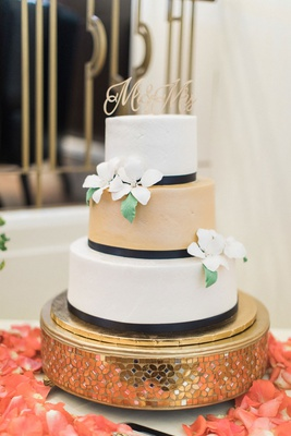 Wedding cake with three layers black ribbon white gold tier sugar flowers mr and mrs cake topper