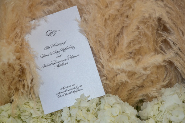 white black classic ceremony program with pampas grass and white flowers