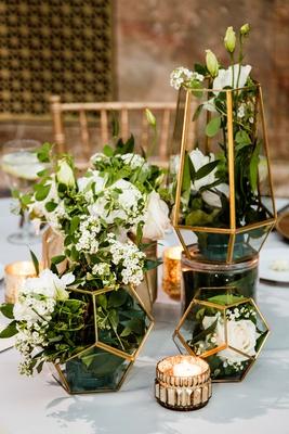 wedding reception gold candle votives gold terrarium geometric vessel white flower greenery