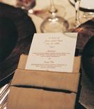 White menu stationery in gold linen napkin
