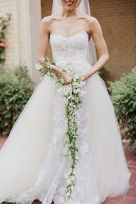 unique bridal bouquet, cascading garland of white flowers