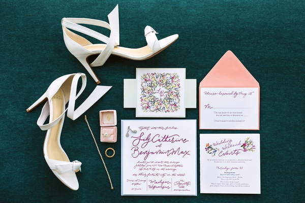 colorful invitation suite with rings in blush mrs. box and white bridal shoes