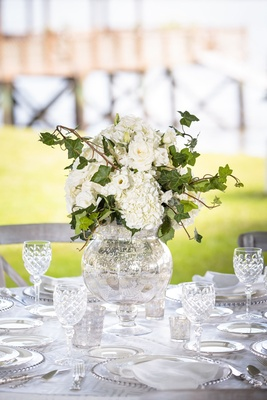 mercury glass vase with ivy, white peonies, hydrangeas, orchids, and stocks