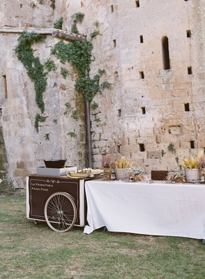 wedding reception at old 12th century abbey fried italian food cart station italy