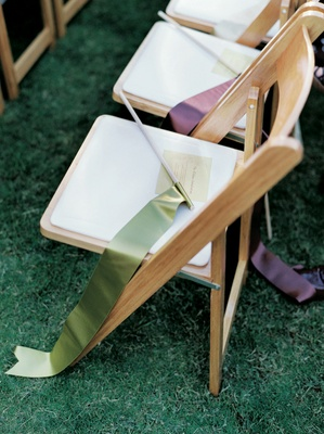 Green and brown ribbons on wedding ceremony chairs