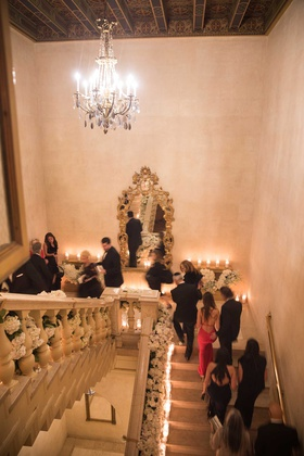 wedding reception grand staircase candles flowers guests walking up staircase