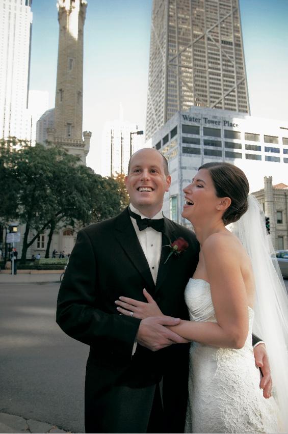 Groom in tuxedo and bride in Carolina Herrera