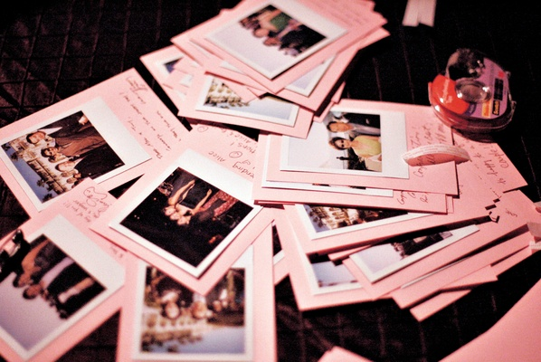 Photos of guests on pink paper with notes
