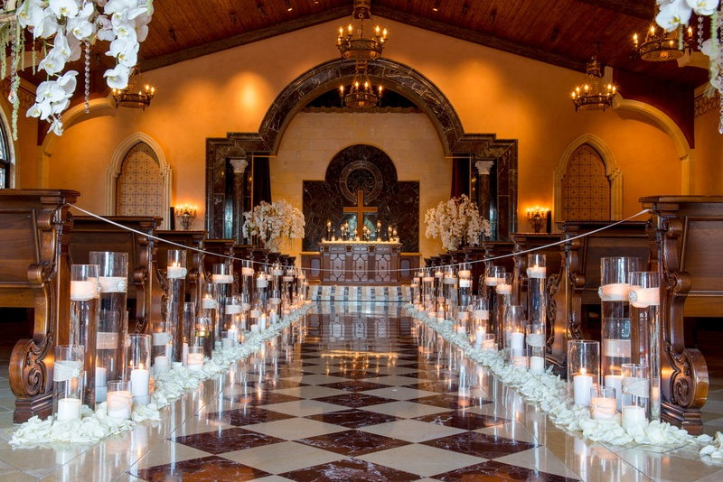 Wedding Ceremony Lined With Candles In Hurricanes Rose Petals At The Base